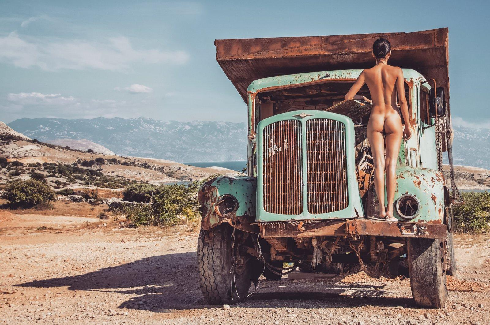 Nude girl on the abandoned truck in Krk Island Croatia