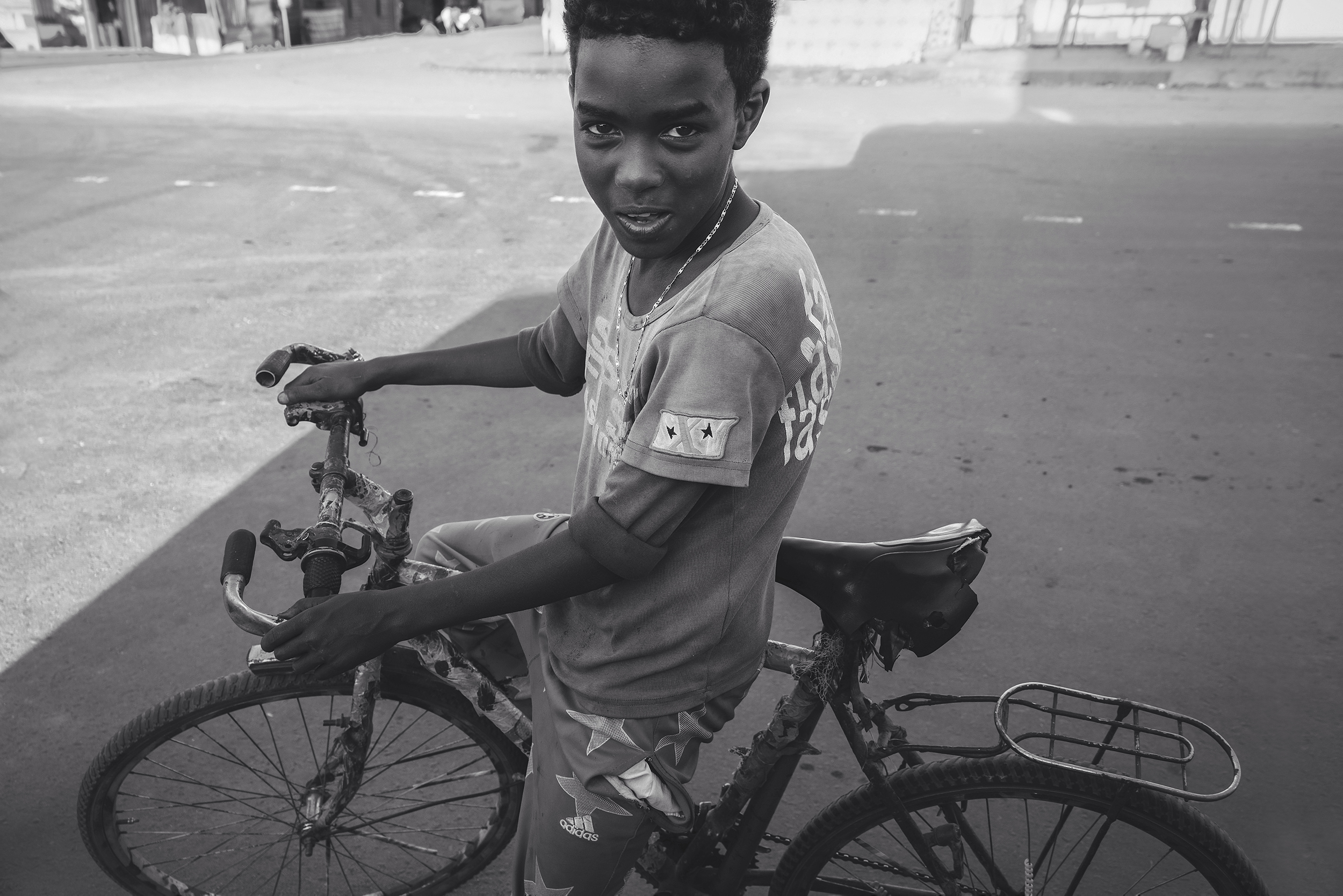 Kenyan boy and his bicycle
